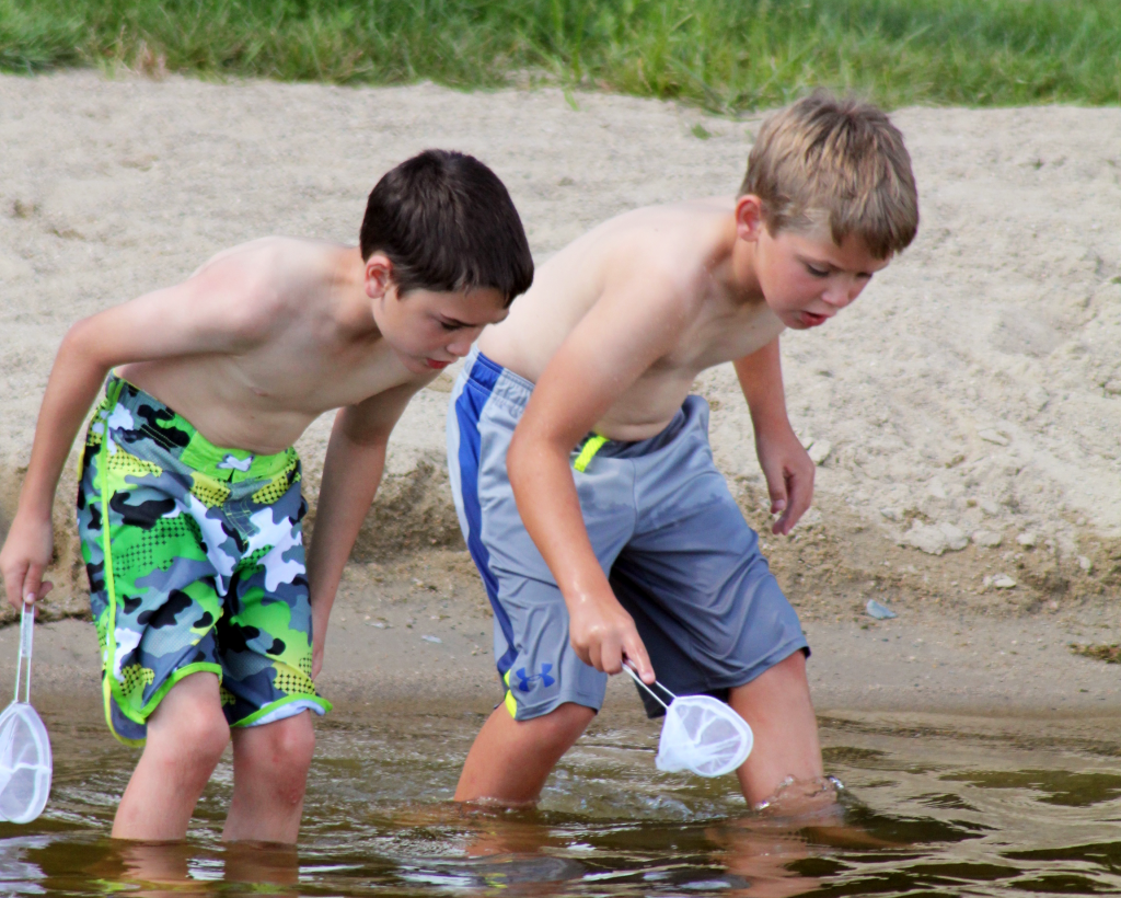 children playing in minnesota lake