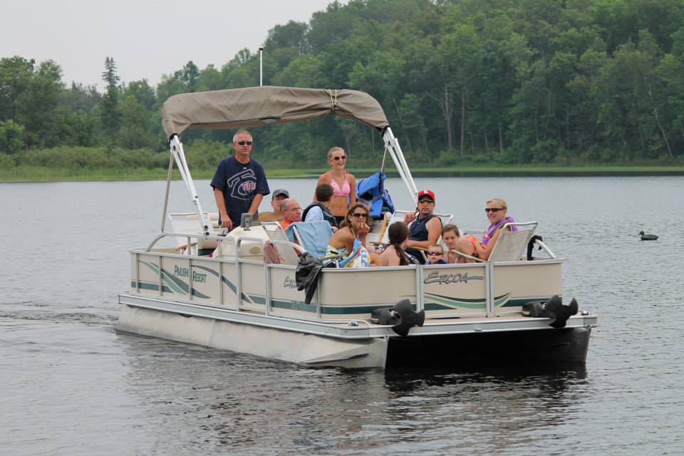 Family enjoying a day on a pontoon at Pimushe Resort